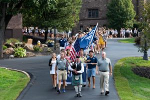 This procession marches through campus during Convocation 2019.  Photo Courtesy of Hill Snap Shots