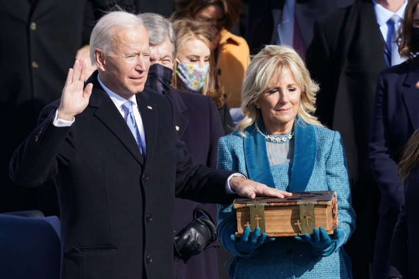 Mr. Joe Biden being sworn in as the 46th President of the United States in Washington on Jan 20, 2021. Biden is using his family Bible. Photo: Reuters.