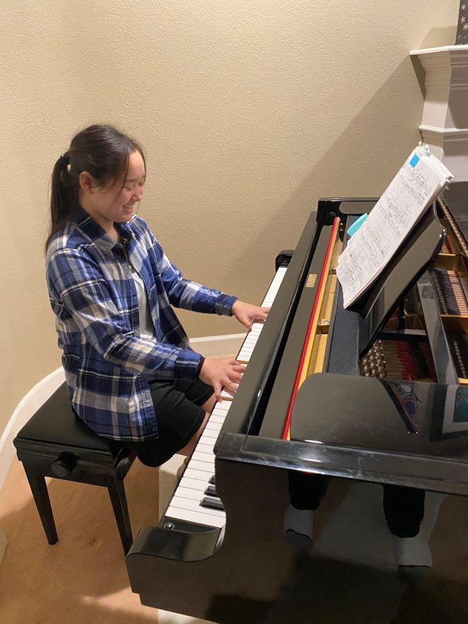 McNay has been regularly practicing the piano in preparation for upcoming music exams. Photo courtesy of Carolyn McNay