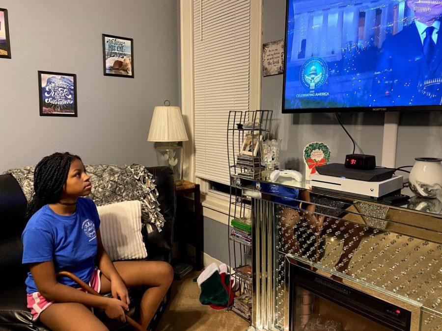 Diamond Henderson watches the Celebrating America concert. Photo By MoniYah Person-Henderson 23