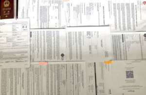 All of my paperwork in order to get back to the U.S. (*Blurred for privacy)