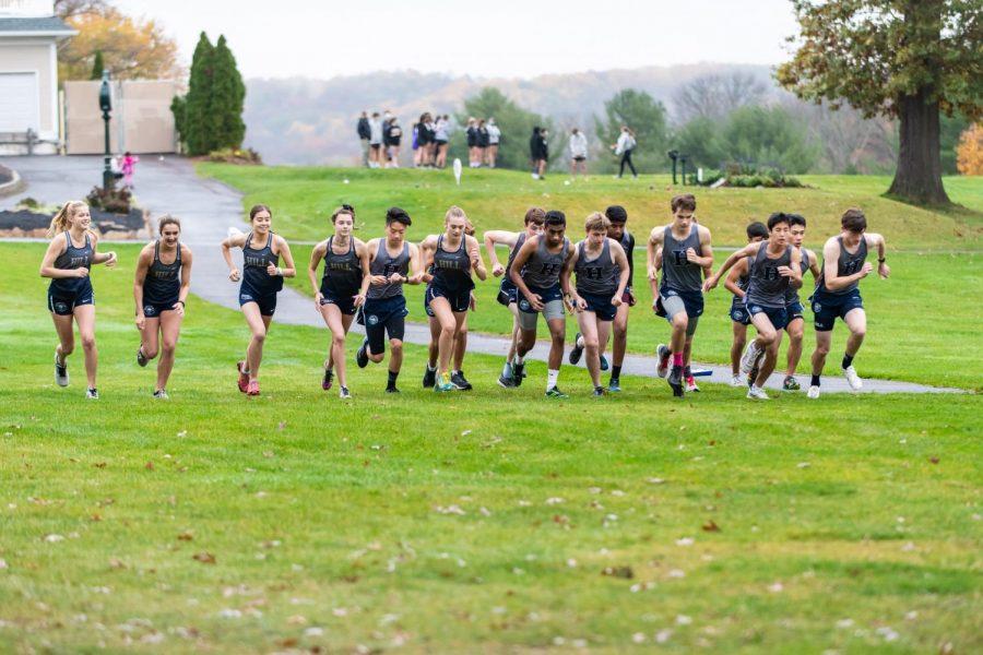 The Hill School boys and girls cross country teams run together. Photo by Sandi Yanisko