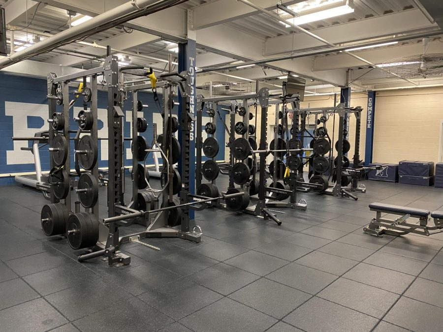 Racks are located in the middle of the weight room for lifting. Photo by Pierce Hart