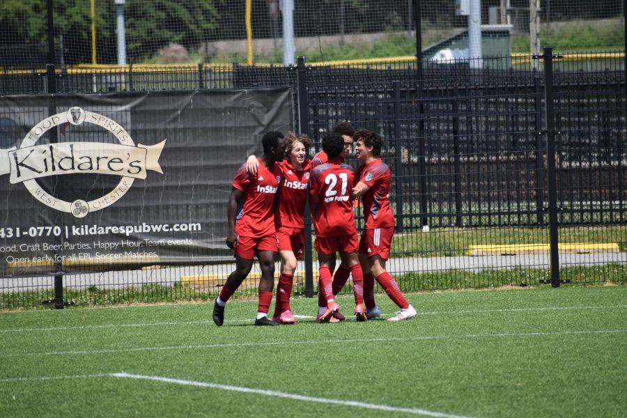 Gavin Mpiana 23 celebrates with his club soccer teammates.